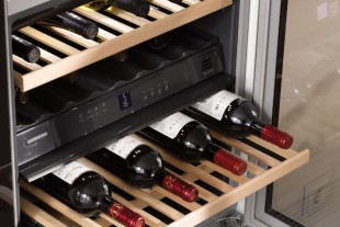 Wine cabinet interiors feature natural beech shelves.